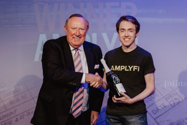 Daniel James receiving The Spectator Economic Disruptor of the Year Award from Andrew Neil